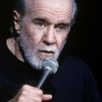 Picture of George Carlin with a microphone