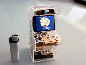 "SpritesMods has come up with the world's smallest arcade gaming machine which lets you play MAME emulator supported games such as Bubble Bobble, Nemesis and Robotron. Dubbed the ""Raspberry Pi micro arcade machine"" has a surprisingly 320×240 pixel LCD display which measures at just 2.4 inches. The framework is fully transparent which gives it a very cool look. There's also a 128×32 white OLED screen at the top of the main LCD screen which displays the logo of the game being currently played on it."