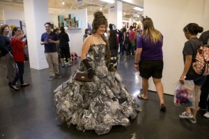 In this Saturday, June 6, 2015 photo, Laura Mart wears a dress with pictures of 300 cats printed on it at CatConLA in Los Angeles. Cats were not the stars of the cat convention, their humans were. They came in droves, pumped and ready to talk about cats, act like cats and embrace or buy all things cat. (AP Photo/Jae C. Hong)